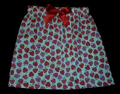 New girls cute pink and red strawberry patterned skirt with red bow. Age 4-6