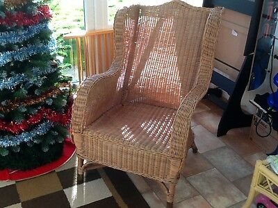 wicker chair. High winged back.
