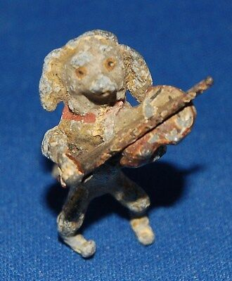 A lovely painted tiny model of a dog (spaniel ?) musician playing a violin