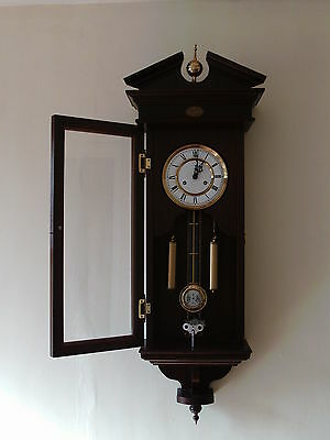 Wall clock as seen in pictures  30 day/chime hour/1/2 hour great condition