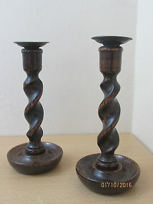 Antique pair of hand turned graduated twist wooden candlesticks. Vintage Treen