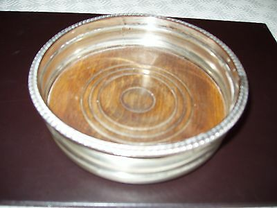 Silver and wooden bottle coaster