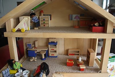 Children's Wooden Toy House and accessories.