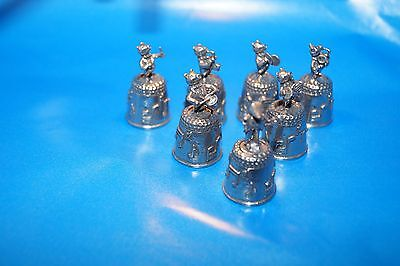 A collection of thimbles of metal music orchestra pigs