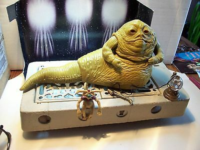 star wars..........JABBA the hut ON HIS THRONE