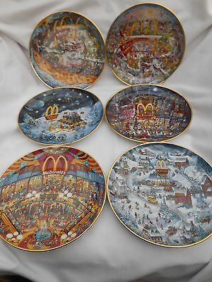 Set of Bill Bell collector plates featuring McDonalds from the 1990s