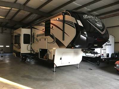 2014 Grand Design Momentum fith wheel toy hauler  385 TH