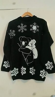 christmas jumper with snowflakes and koalas