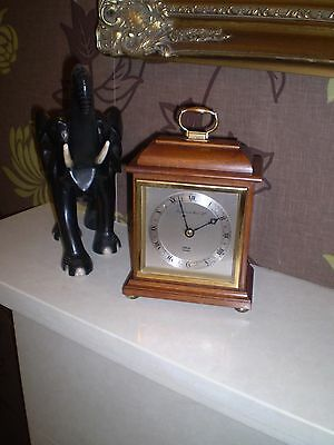 A  mantel clock retailed By Mappin & Webb. City EC1,  Made By Elliott of London.