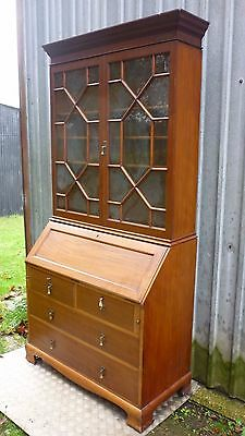 BUREAU / BOOKCASE. With glass doors,  writing slope & drawers