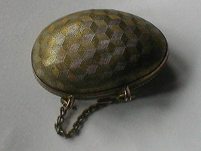 Brass egg thimble case with thimble