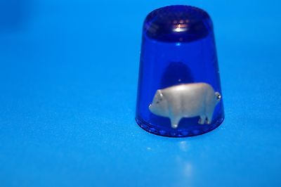 Blue glass thimbles with the cat and pig