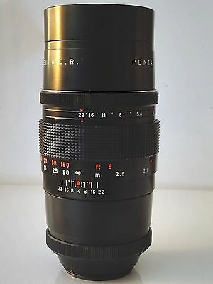 PENTACON f4 200MM TELEPHOTO LENS IN GOOD CONDITION.