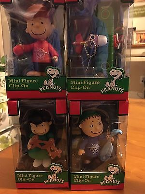 4 Peanuts Mini Figure Clip-On - Snoopy, Charlie, Linus, and Lucy Figurines