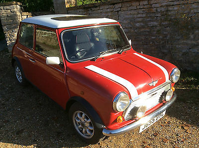MINI COOPER 1.3I 1992 RED with white roof.