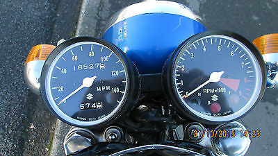 Suzuki T250 T350 T500 a pair of new Speedo and Tacho outer clock bodies.seconds