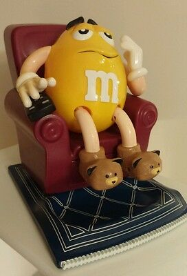M&M Candy Dispenser - Yellow M&M In Recliner With Remote - Dated May 22, 1999