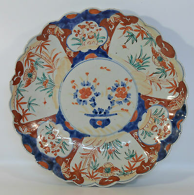 A 19th century Japanese Meiji period scallop moulded Imari plate/charger