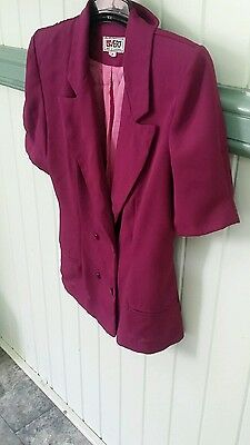 Ladies late 80's suit.  Complete with shoulder pads . Size 8