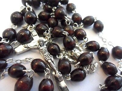 Rosary beads, dark brown oval wood, silver colour metal crucifix & links