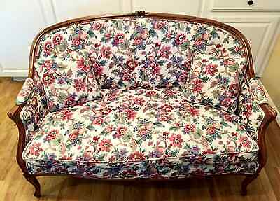 Antique Loveseat with Floral Upholstery