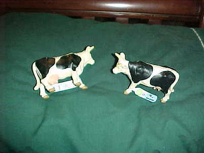 a pair of bullyland black & white cows..milkers i guess..no pvc..new with label