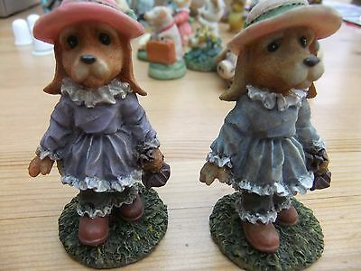 Two  Dog Figurine (girls with hats)