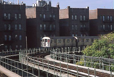 NYCTA Transit subway slide. R62 train by Howard Avenue in Brownsville, Brooklyn
