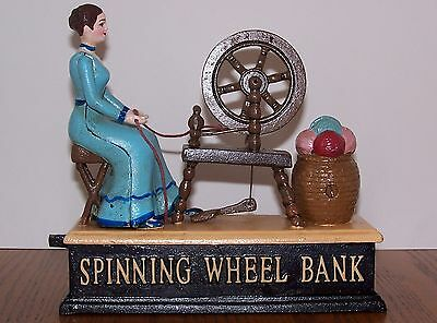 Rare Vintage Reproduction Cast Iron Mechanical Bank Spinning Wheel  Moving Used