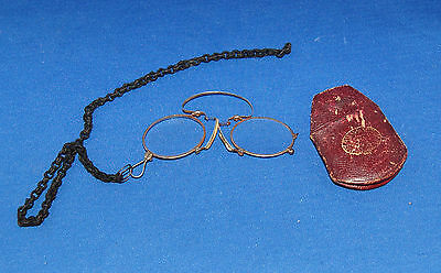 A good example of an antique Victorian set of pince-nez spectacles, leather case