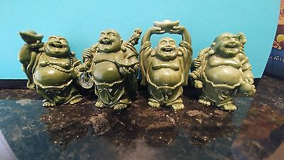 Set of 4 laughing buddhas approx 2 inches high