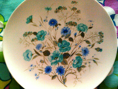 Melmac white plate and blue-turquoise flowers