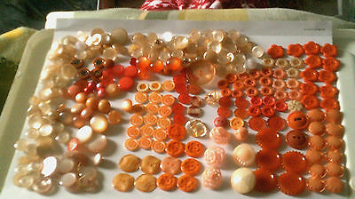Lot over 100 vintage various orange flowers/round plastic/pearl shank/4/2 holes
