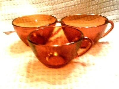 Has to go! 3 cups amber glass