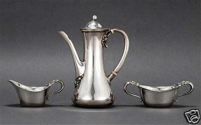 TIFFANY & CO.THREE-PIECE STERLING SILVER CLOVER PATTERN COFFEE SERVICE New YorK