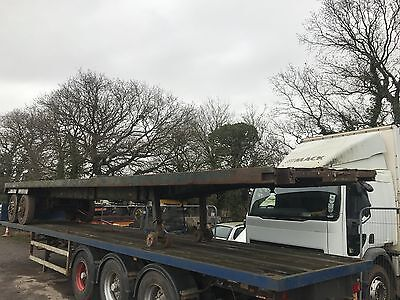 40 ft flat trailer, two axles on springs, solid chassis and floor.