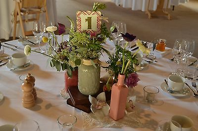 Shabby chic/rustic/vintage barn wedding centre pieces props. Jars/vases/bottles.