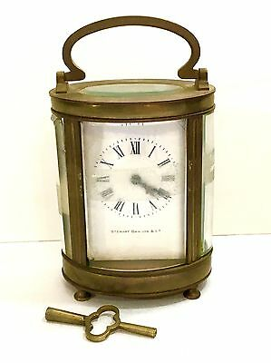 """OVAL FRENCH BRASS CARRIAGE CLOCK Retailed by Stewart Dawson Stamped """"FRANCE"""""""