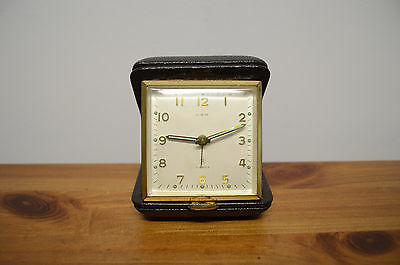 LSM  - Vintage travel clock in brown leather case - manual wind