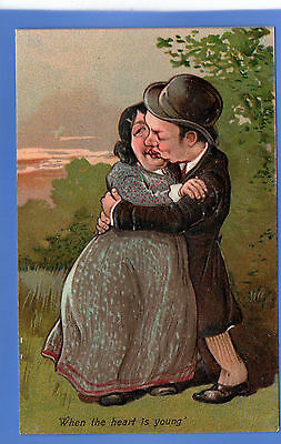 Vintage Embossed Postcard When The Heart Is Young Valentine Man Woman Kissing