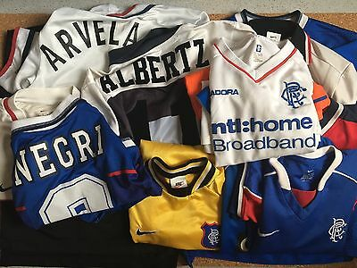 A Large Job lot of Retro old Glasgow Rangers Football Shirts/ all (kids sizes)