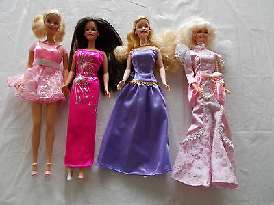 4 Barbie Dolls with Clothing (LOT #7)