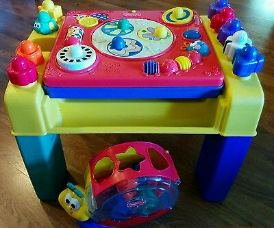 Fisher price activity table and posting snail