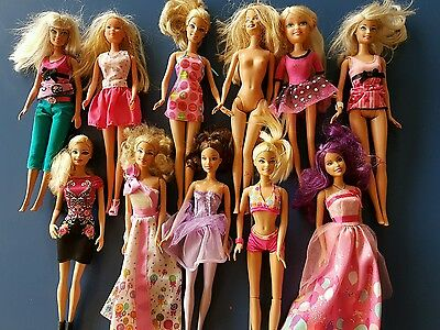 11 barbie dolls in good condition