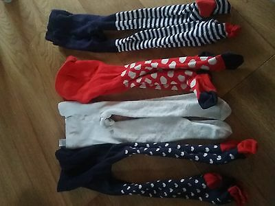 4 pairs of girls tights age 12-18mths