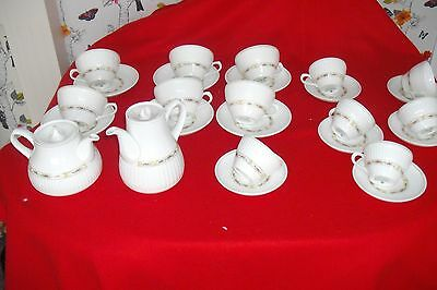a tea set and coffee by insignia for six  wedgwood