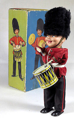 Antique Drummer soldier with busby wind up clockwork toy with original box
