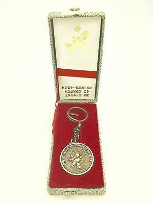 The 11th Asian Games 1990 Memorable Anniversary Medal Keychain
