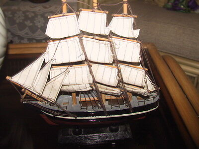 Old tall sail wooden ship on stand