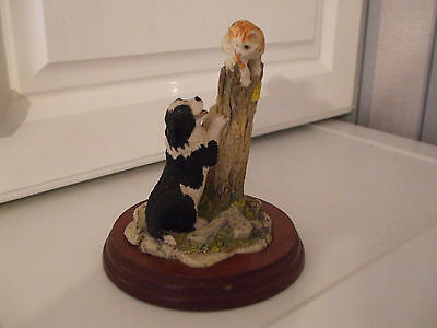 border fine arts figure of a dog and cat